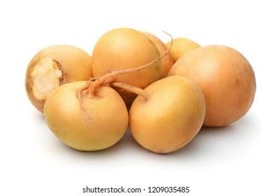 Group of fresh yellow turnips isolated on white