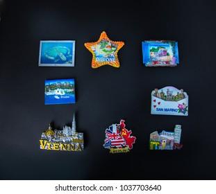 Group of Fridge magnets Souvenirs from Italy, Germany, Austria, Egypt, Croatia, Greece, Dubai on black background