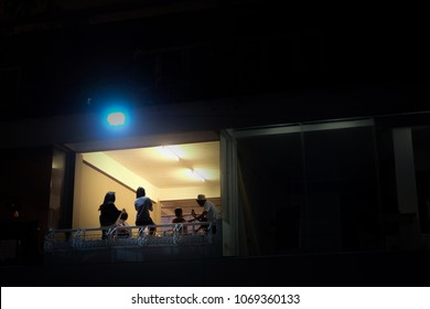 Group of friend enjoying night party on terrace