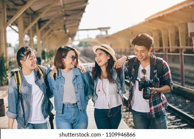 Group of friend traveler on the train ,Travel lifestyle and seasonal vacation concept in thailand.