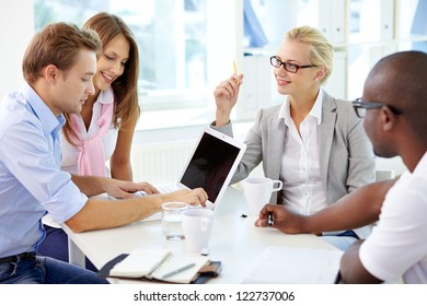 Group of friendly businesspeople having meeting