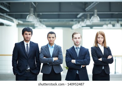 Group of friendly businesspeople in suits standing in line