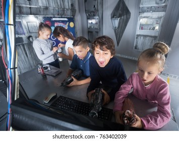 Group of friendly children are concentrating on finding a way out of mysterious bunker