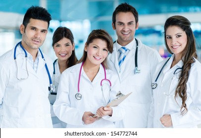Group of friendly doctors working together and smiling