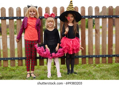 Group of friendly girls wearing traditional halloween costumes