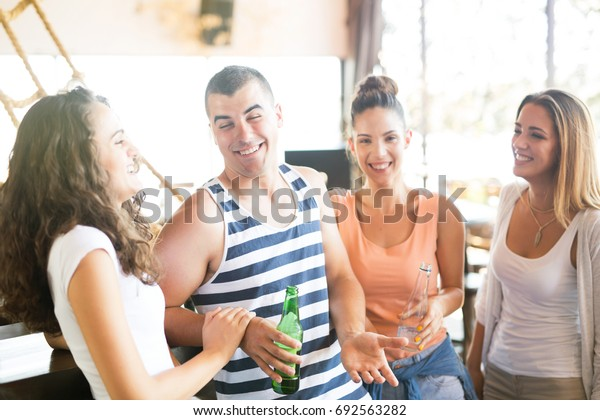 Group of friends in the bar
