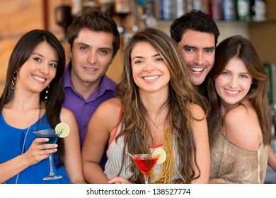 Group of friends at the bar having drinks