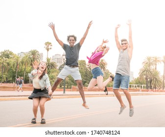 A group of friends being happy and jumping in the city.