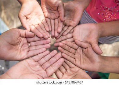 Group of friends bonding hands together