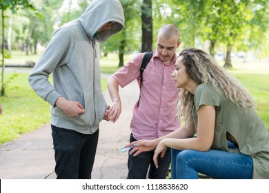 Group of friends buying drugs from their local drug dealer