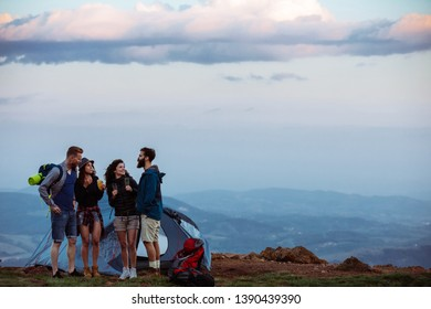 Group of friends camping at the top of the mountain