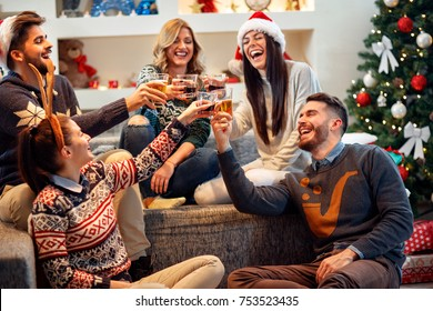 Group of friends celebrating Christmas at home, they are having fun