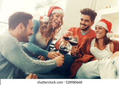 Group of friends celebrating Christmas at home,they are having fun.