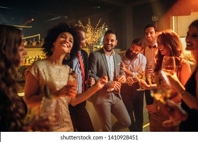 Group of friends celebrating with drinks