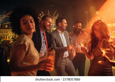 Group of friends celebrating with drinks.