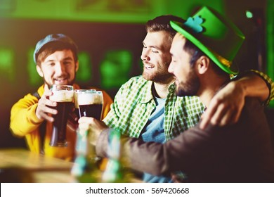 Group of Friends Celebrating at Irish Pub