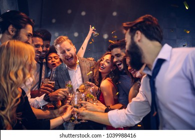 Group of friends celebrating at a nightclub