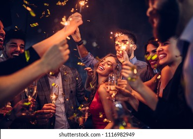 Group of friends celebrating at the nightclub