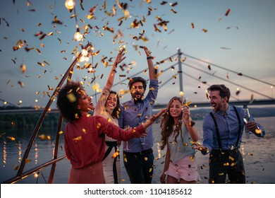 Group of friends celebrating on a boat cruise