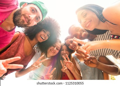 group of friends in a circle having fun. college students smiling, taking photo together. carefree young people in happy moments. concept of unity, diversity, teamwork and togetherness.