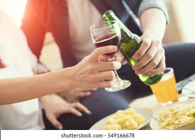 Group of friends clinking flutes with sparkling wine, beer a People Party Celebration Concept