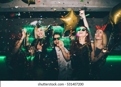 Group of friends at club having fun. New year's party