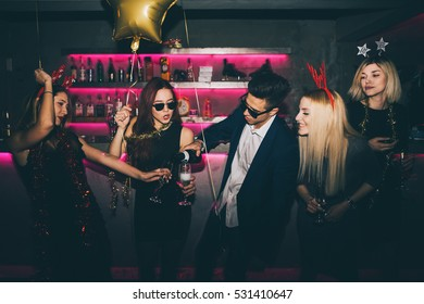 Group of friends at club having fun