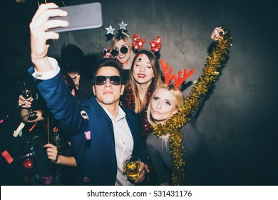 Group of friends at club making selfie and having fun