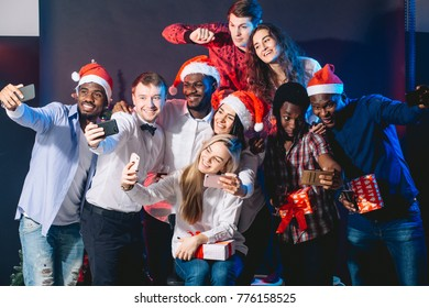 Group of friends at club making selfie and having fun. Christmas and New year concept
