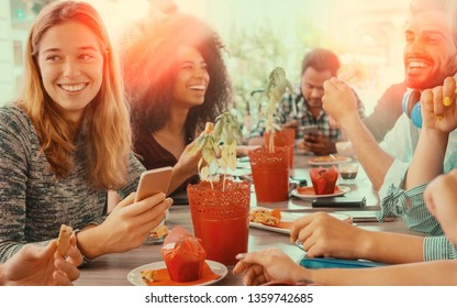 group of friends at coffee shop having breakfast together.  colleagues of work sitting at cafeteria laughing talking and eating together. concept of togetherness and teamwork