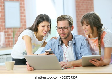 Group of friends connected together on laptop and tablet