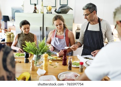 Group of friends are cooking in the kitchen