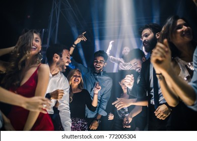Group of friends dancing in the nightclub