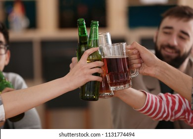 Group of friends drinking beer in bar
