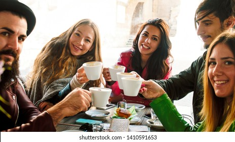group of friends drinking coffee together sitting at the table. high contrast image