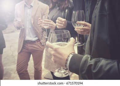 group of friends drinking wine, people is socializing and having a fun (this version has slightly desaturated colors)