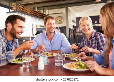 A group of friends eating at a restaurant