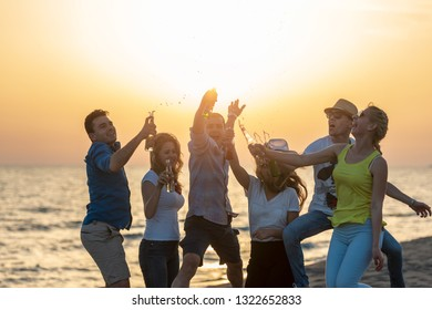 Group of friends enjoy on the beach