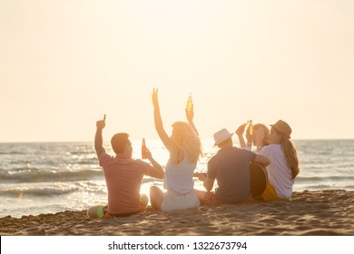 Group of friends enjoy on the beach