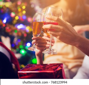 Group Of Friends Enjoying Christmas Drinks In Bar Celebrating x mas at home