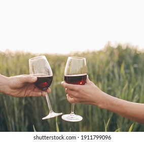 Group of Friends Enjoying Drink, Outdoor, toasting wine. Couple in love. Wine glass.