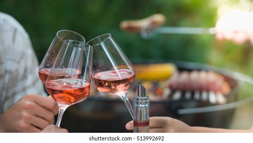 Group of Friends Enjoying Drink, Outdoor, toasting rose wine