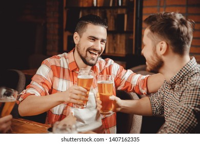 Group of friends enjoying drink pub, tells funny story.