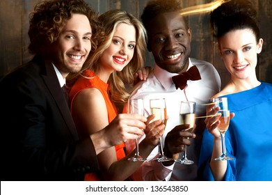 Group of friends enjoying drinks together in restaurant bar.