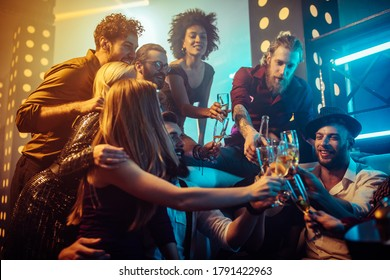 Group of friends enjoying drinks together at the nightclub