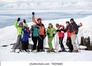 Group of friends, enjoying at mountain ski resort