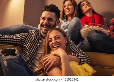 Group of friends enjoying movie time at home.