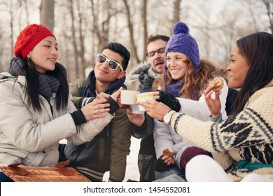 Group of friends enjoying in the snow in winter