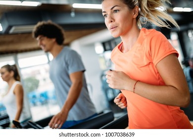 Group of friends exercising on treadmill machine