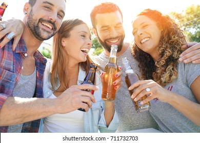 Group of friends gathering in bar drinking beers